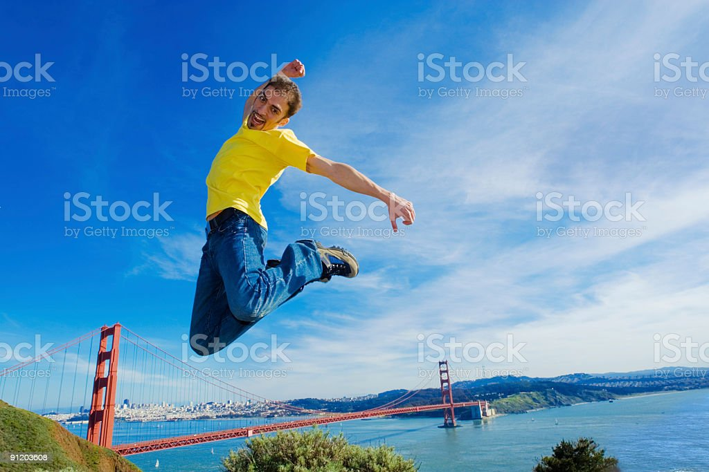 Happy tourist jumping high in the air royalty-free stock photo