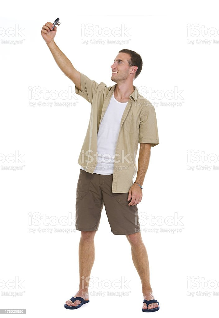 Happy tourist making photos of himself royalty-free stock photo