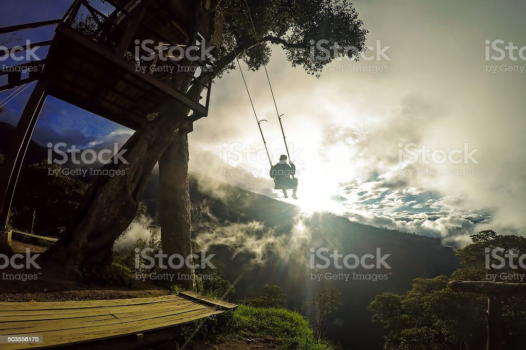 Happy Tourist Man Swinging On A Swing, Tree House stock photo
