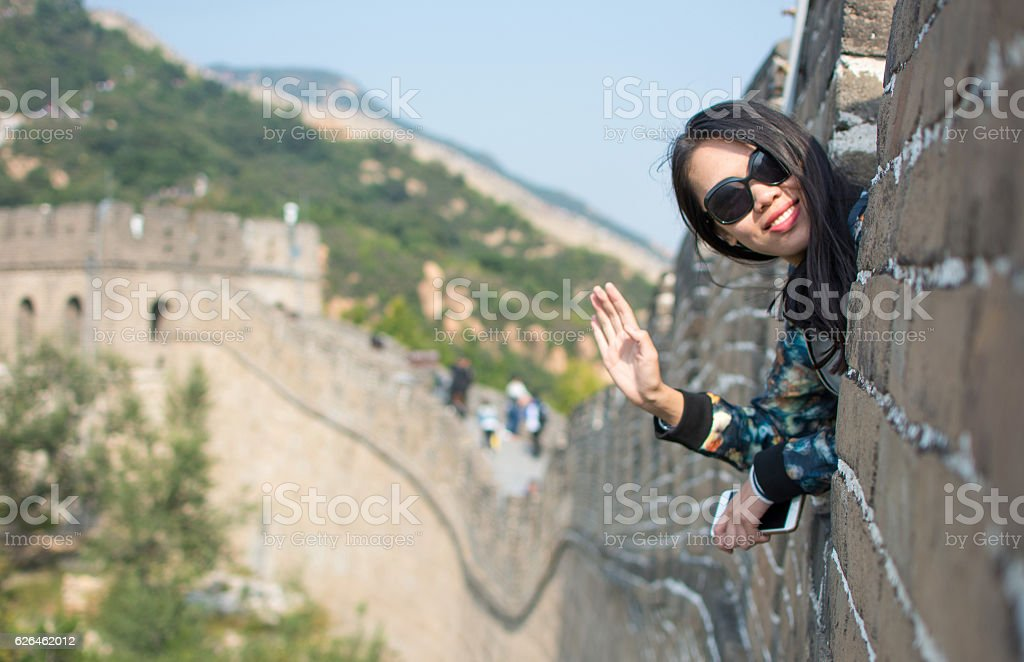 Happy tourist on the Great Wall of China stock photo