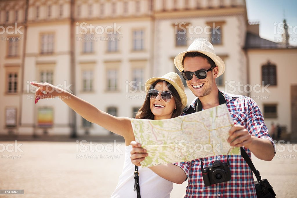 Happy tourist sightseeing city with map stock photo