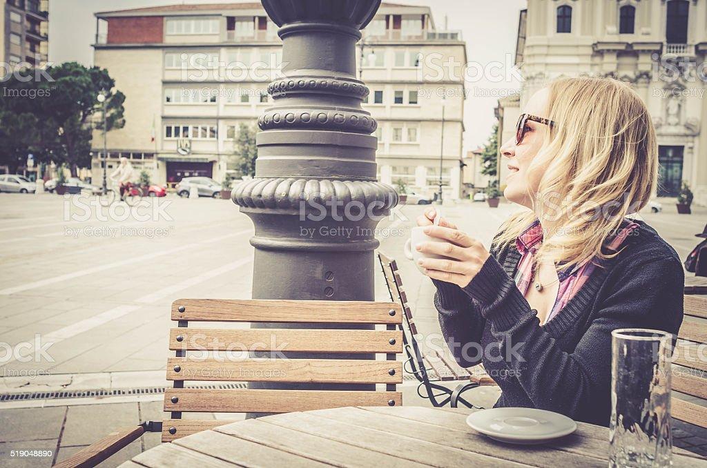 Happy Tourist Woman drinking coffee, bar in Italy, Gorizia stock photo