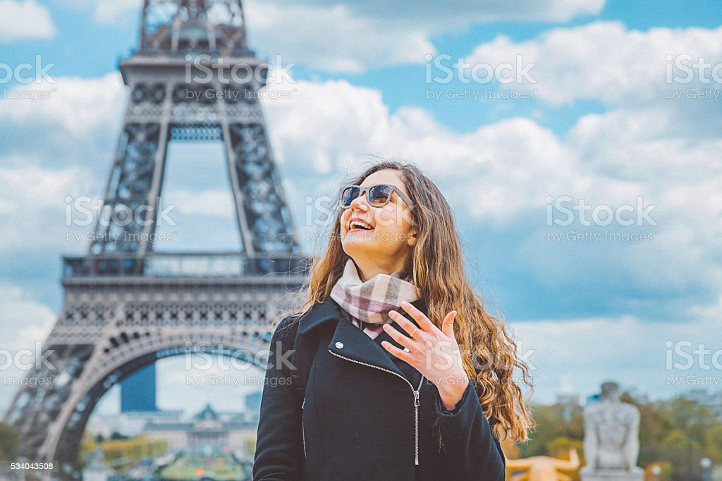 Happy tourist woman enjoying Paris stock photo