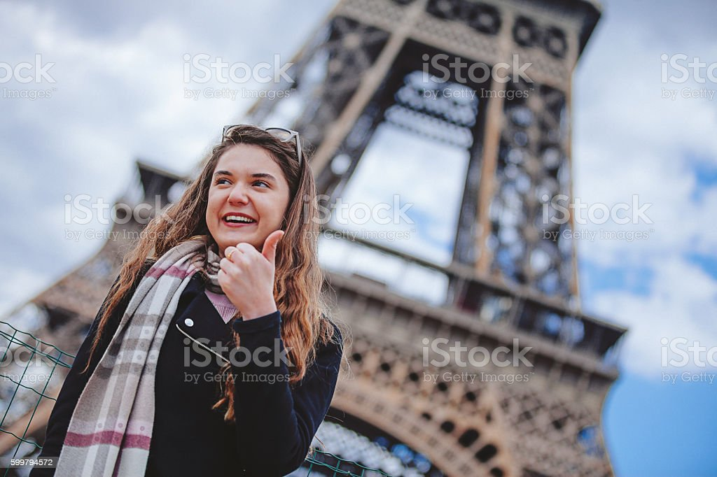 Happy tourist woman showing thumbs up in Paris stock photo