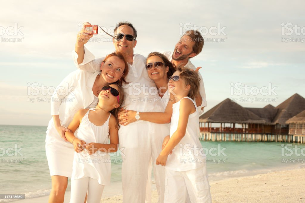 happy tourists making a snapshot on the beach royalty-free stock photo