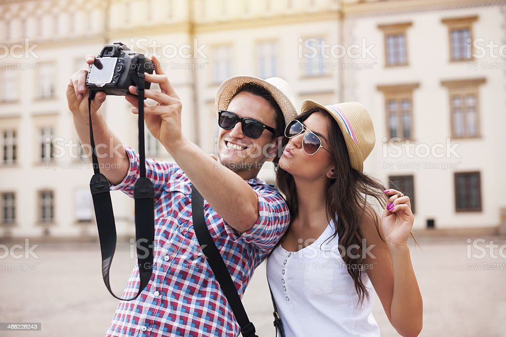 Happy tourists taking photo of themselves stock photo