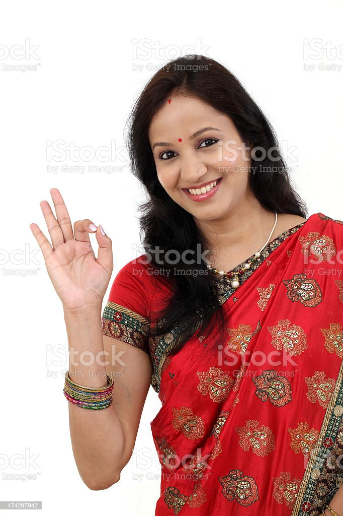 Happy traditional Indian woman making ok gesture stock photo
