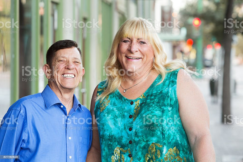 Happy transgender male and female outside stock photo