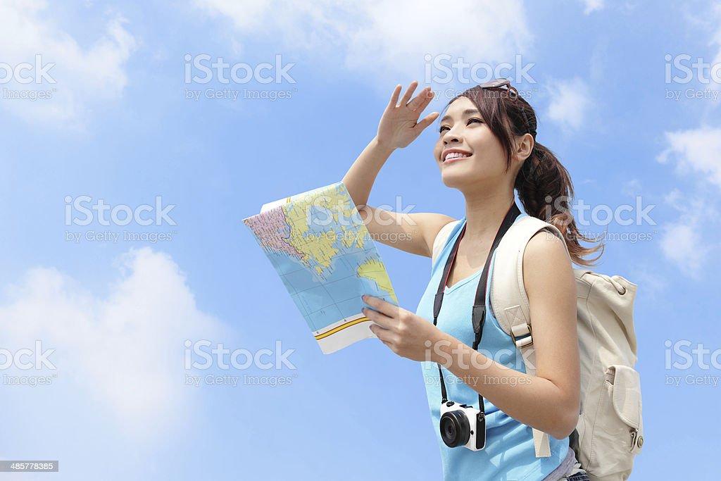 Happy travel woman look map stock photo