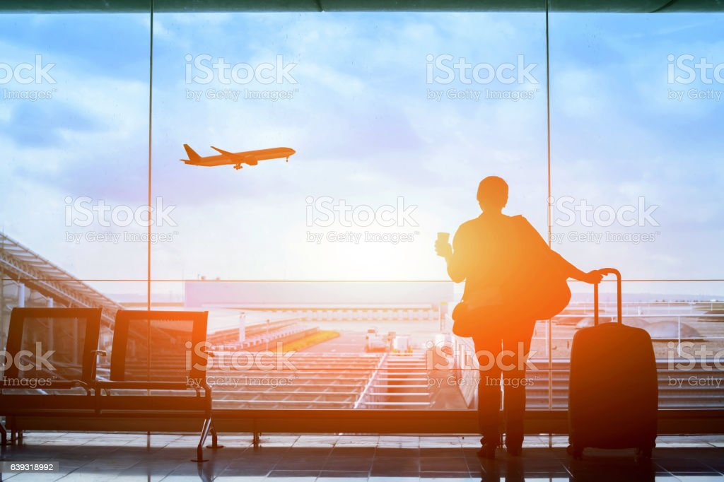 happy traveler waiting for the flight in airport stock photo