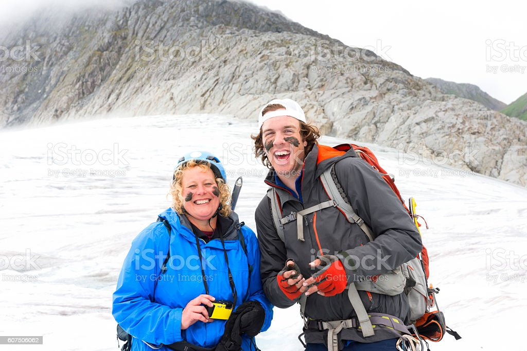 Happy trekkers with mud on faces stock photo