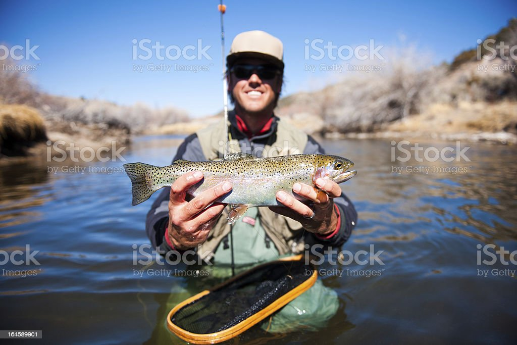 Happy Trout Fisherman stock photo
