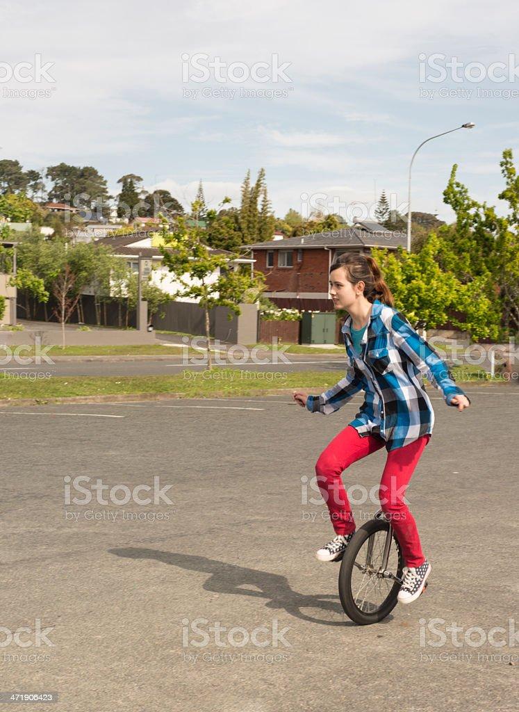Happy unicyclist stock photo