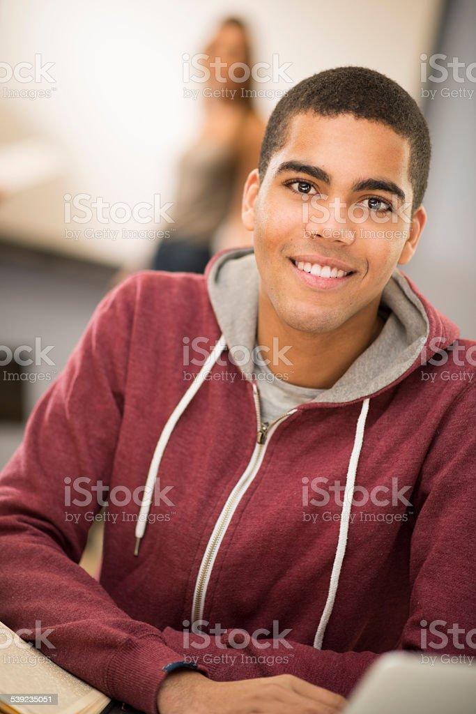 happy university student in class stock photo