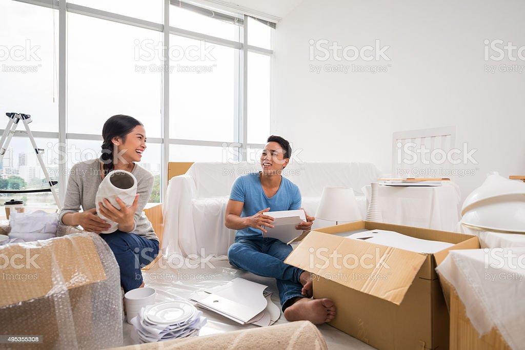 Happy unpacking family stock photo