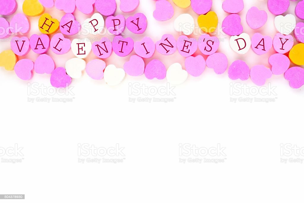 Happy Valentines Day candy hearts top border over white stock photo