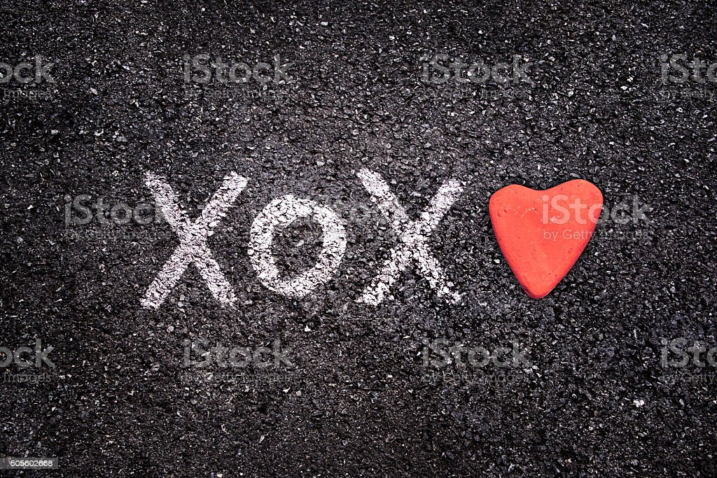 Happy Valentines day card, xoxo on the ground and heart stock photo