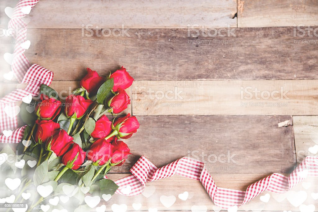 Happy Valentine's Day!  Red roses bouquet, ribbon on rustic table. stock photo