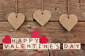Happy Valentines Day wooden blocks with heart decor on wood