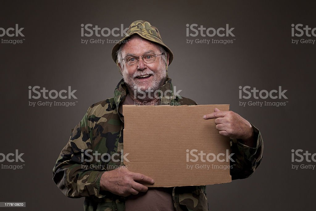 Happy Vietnam Veteran showing a cardboard piece royalty-free stock photo