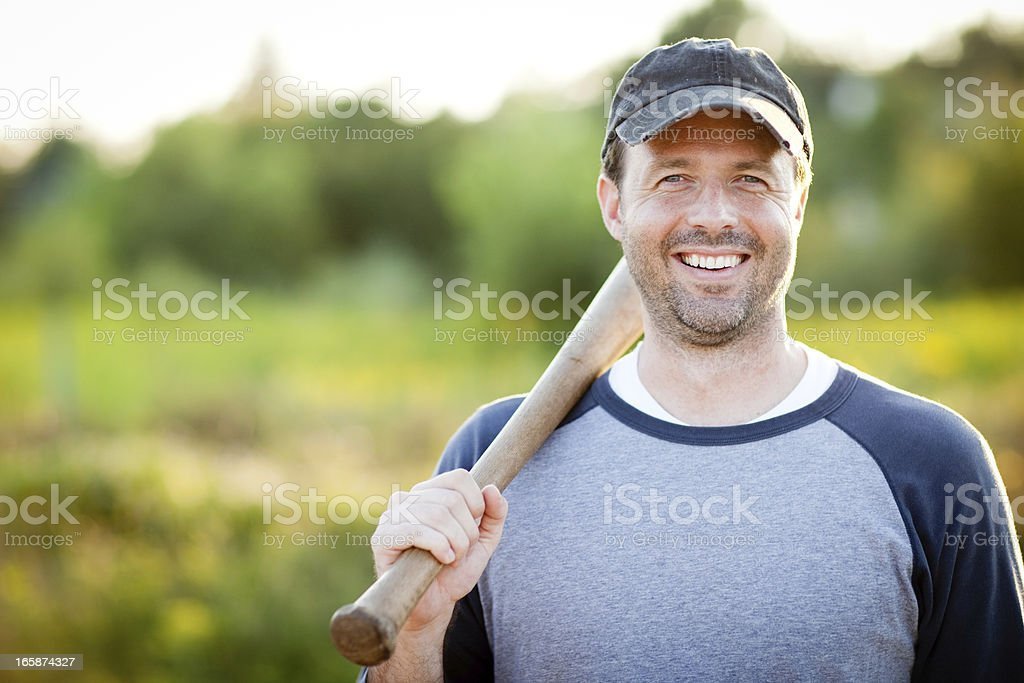 Happy, Vintage Baseball Player with Bat Outside During Summer stock photo