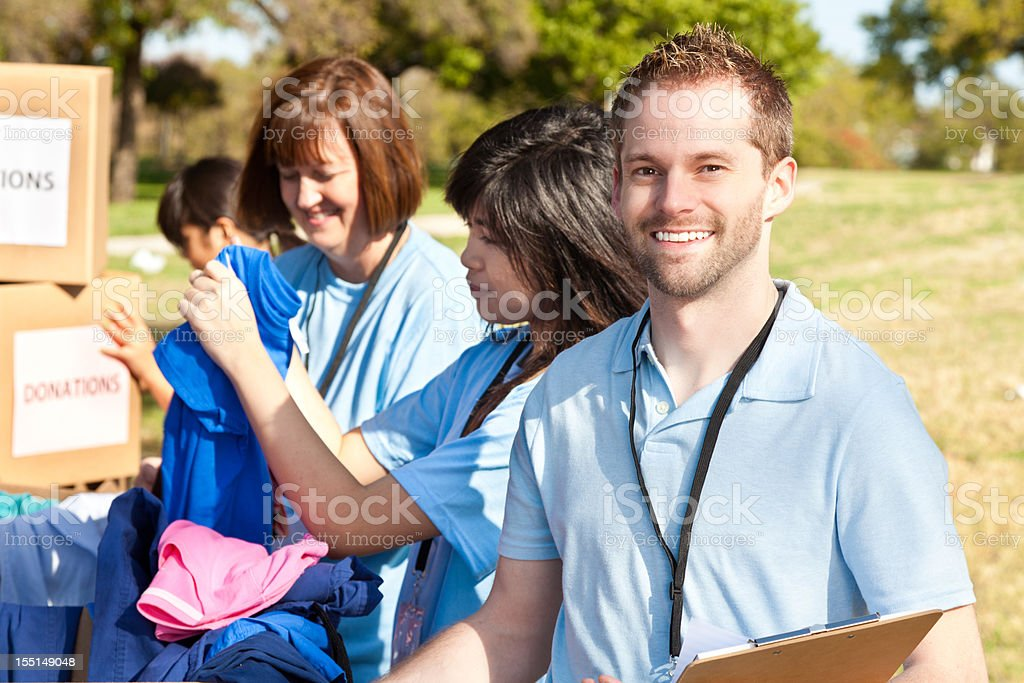 Happy volunteer at donations center royalty-free stock photo