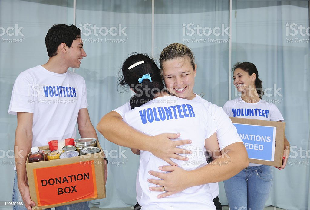 happy volunteer group with food donation stock photo