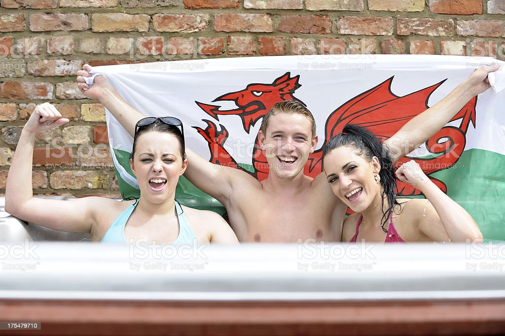 Happy Wales supporters in hot tub stock photo