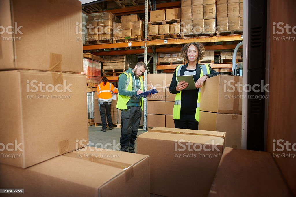 happy warehouse manager stock photo