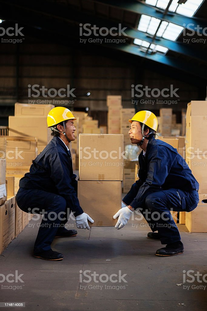 Happy warehouse workers stock photo