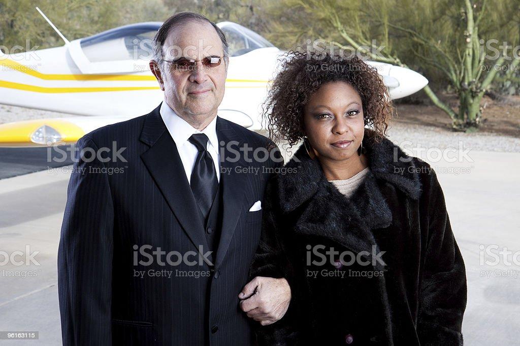 Happy wealthy couple stock photo