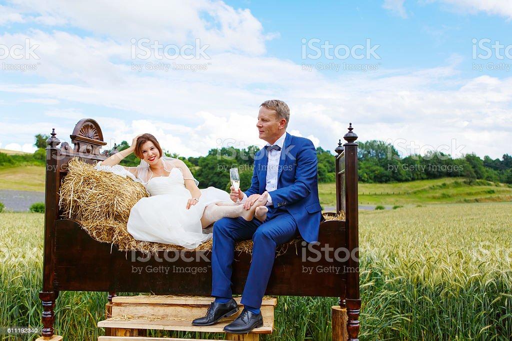 Happy wedding couple in wheat field stock photo