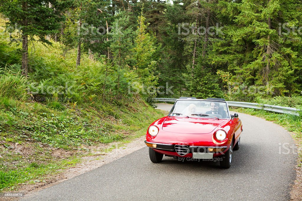 Happy wedding couple with cabriolet stock photo