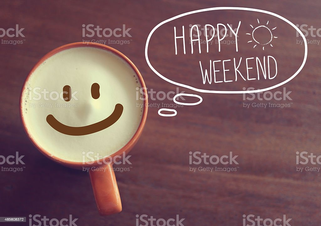 Happy weekend coffee cup background with vintage filter stock photo