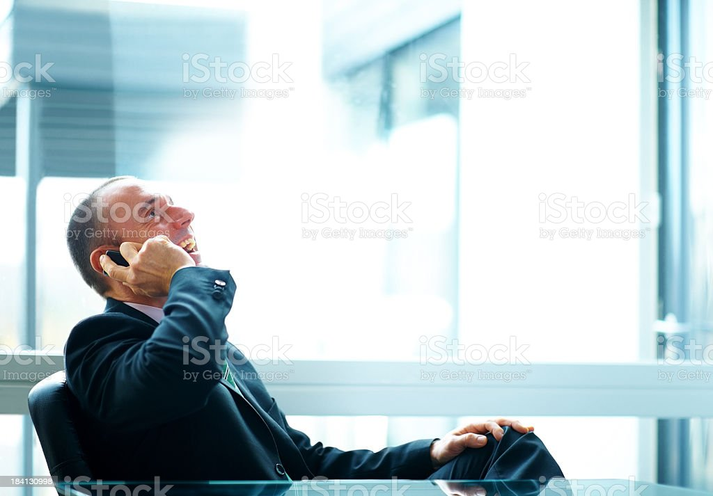 Happy welldressed male using his mobile phone royalty-free stock photo