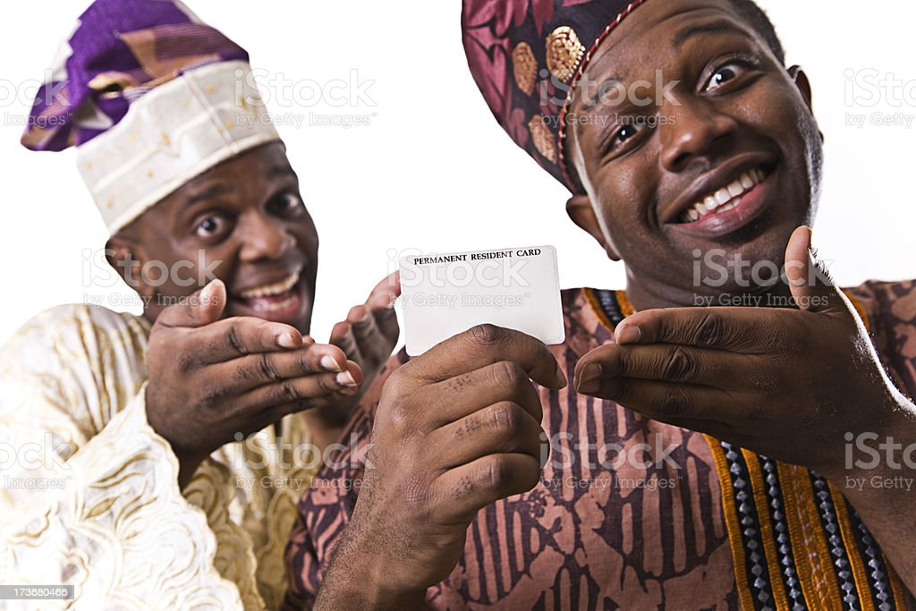 Happy West African Men with Permanent Residence Card stock photo
