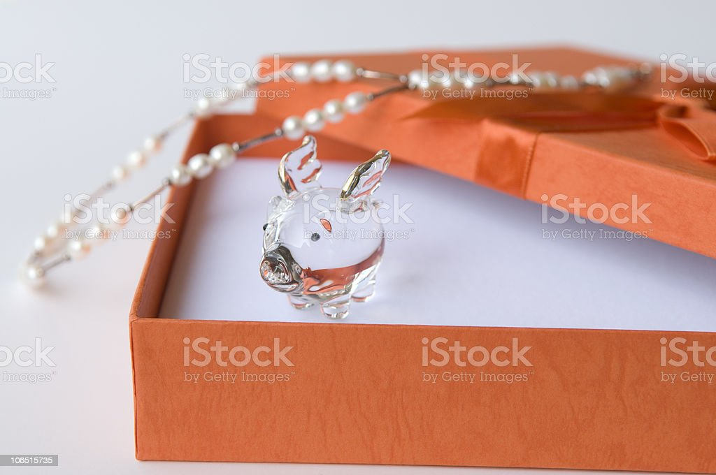 Happy Winged Pig in Gift Box Pearls royalty-free stock photo