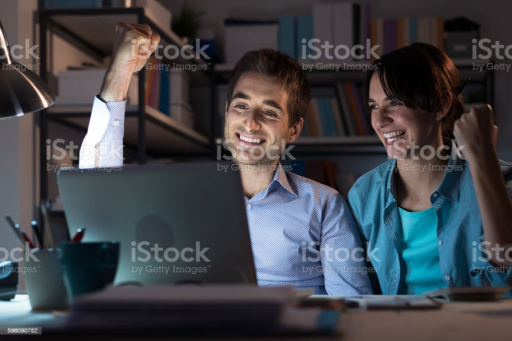 Happy winning couple stock photo
