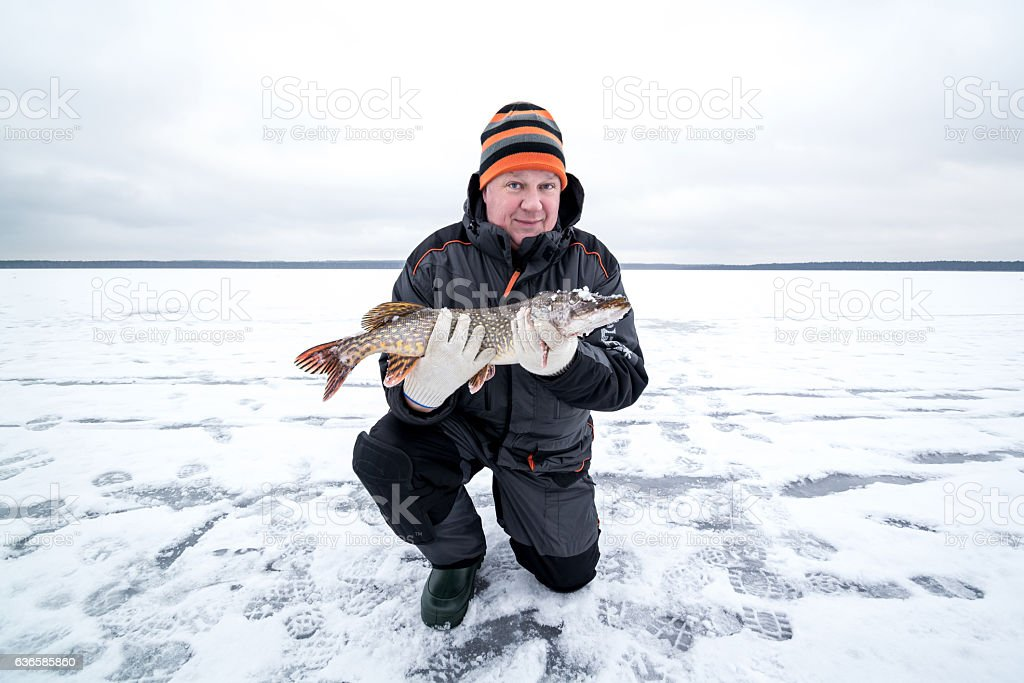 Happy winter fishing in a lake stock photo