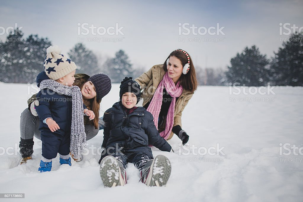 Happy winter kids and mother stock photo