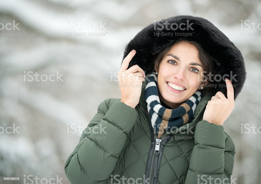 Happy Winter Portrait, Woman enjoying this snowy Winter Day stock photo