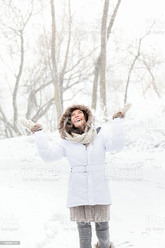 Happy winter woman playing in snow stock photo