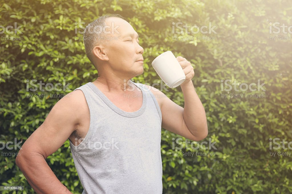 Happy with a cup of coffee, Old man stock photo
