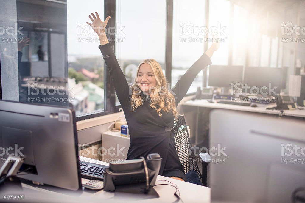 Happy with work at the office stock photo
