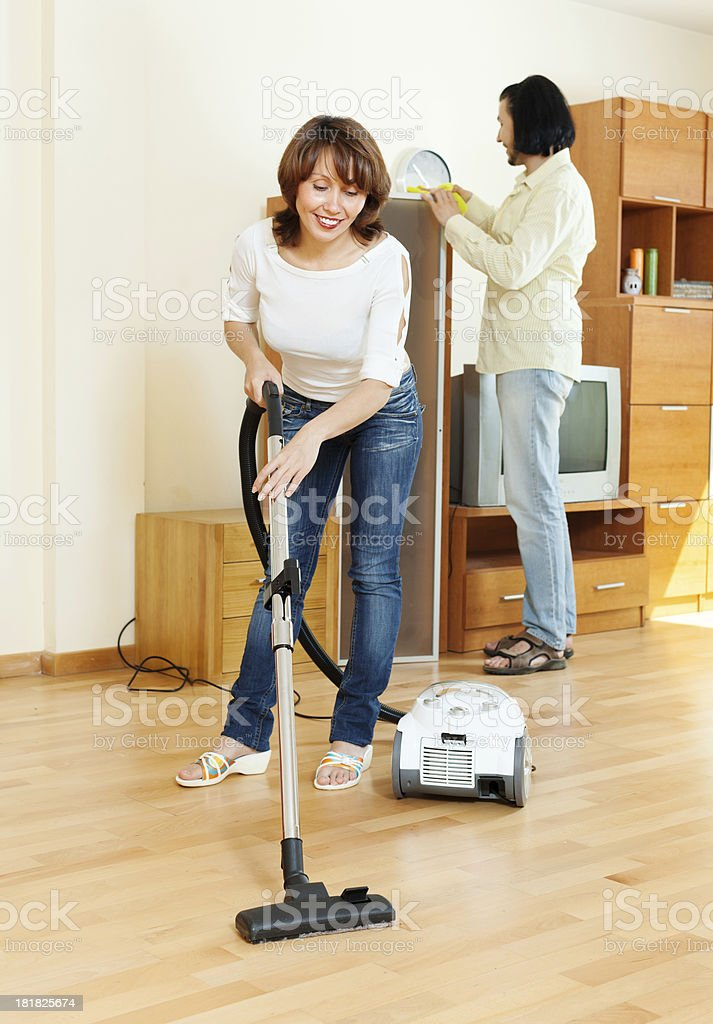 Happy woman and man doing housework royalty-free stock photo