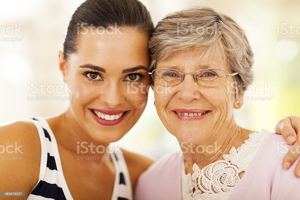 happy woman and senior mother closeup royalty-free stock photo