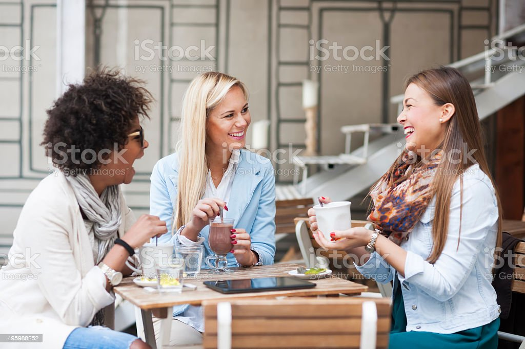Happy woman at cafe stock photo