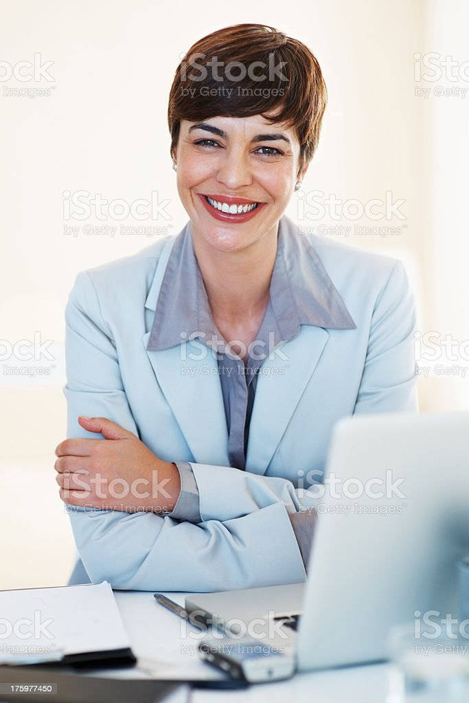 Happy woman at desk stock photo