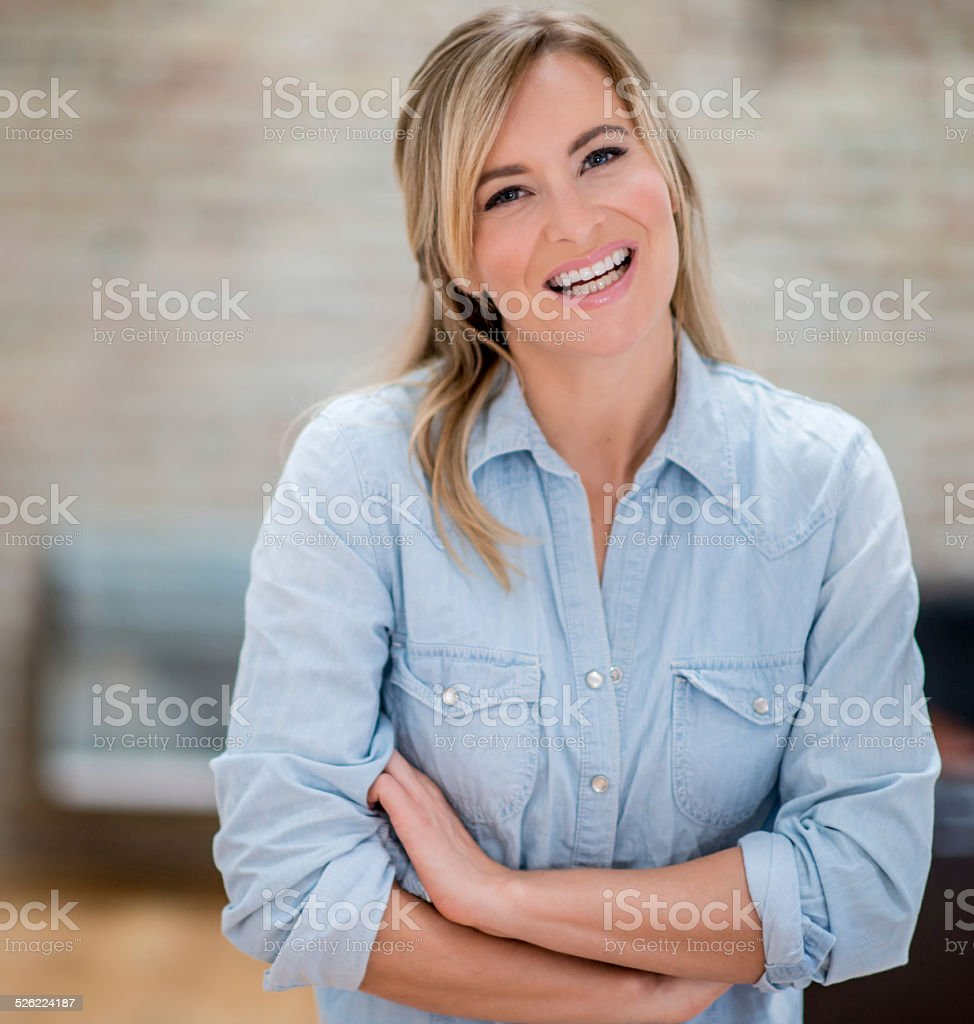 Happy woman at home stock photo