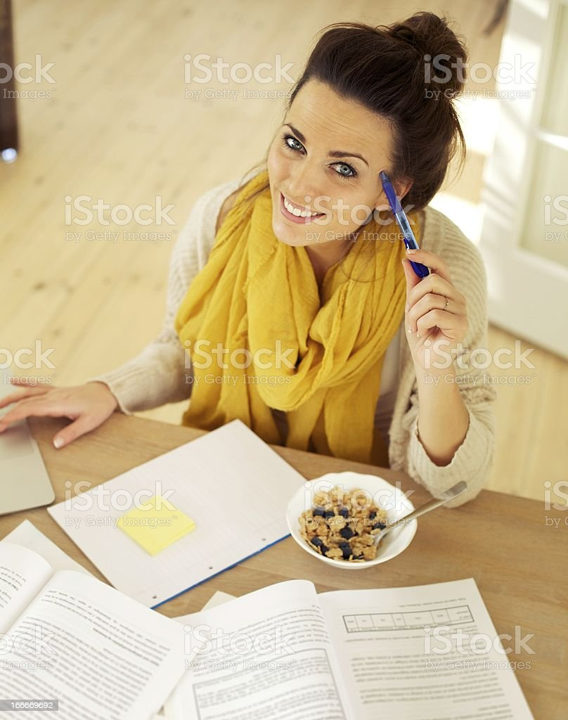 Happy Woman at Home Studying stock photo